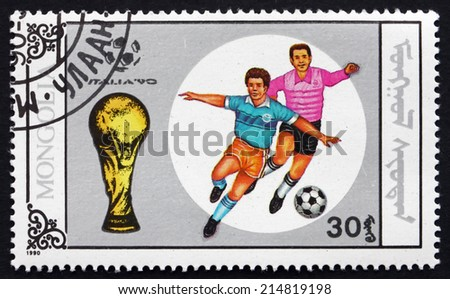 MONGOLIA - CIRCA 1990: a stamp printed in Mongolia shows Soccer Player in Action, 1990 World Cup Soccer Championships, Italy, circa 1990 - stock photo