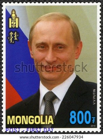 MONGOLIA - CIRCA 2014: A stamp printed in Mongolia shows V.V. Putin, Russian  President, dedicated to the Visit of Vladimir Putin to Mongolia, circa 2014 - stock photo