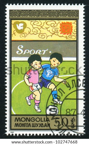 MONGOLIA - CIRCA 1987: stamp printed by Mongolia, shows children Playing soccer, circa 1987