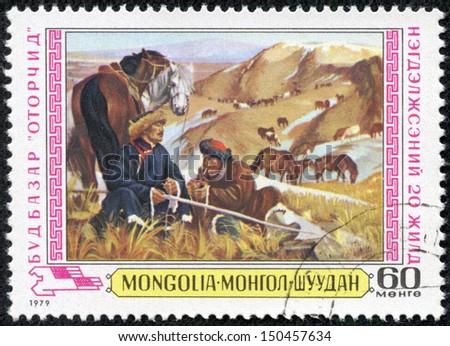 MONGOLIA - CIRCA 1979: stamp printed by Mongolia, shows Herdsmen and horses, circa 1980 - stock photo