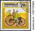 MONGOLIA - CIRCA 1982: stamp printed by Mongolia, shows Man and Woman Standing Near Bicycle, circa 1982 - stock photo