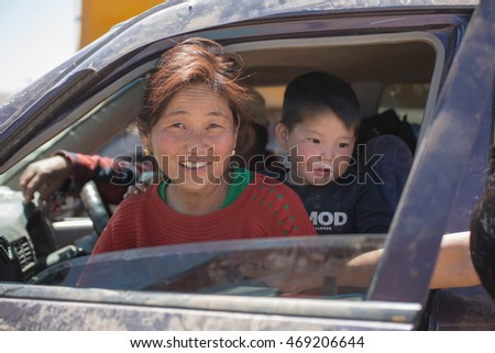 Mongolia-May16,2016- Mongolian family is setting in the car at  countryside of Mongolia