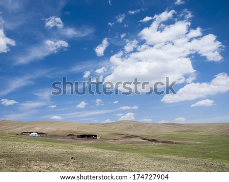 Mongolian steppe with typical ger and stables