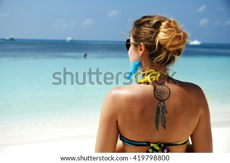 Monika enjoying her holiday at the beach of Kuredu, maldives