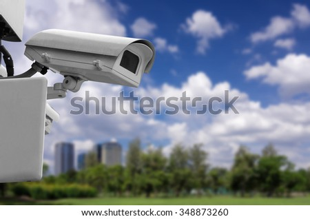 Monitoring security camera The backdrop of the blur building. - stock photo