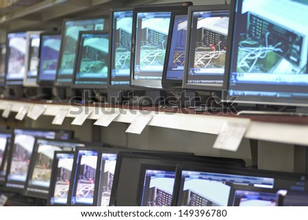 Monitors displayed in shelves at an electronic store