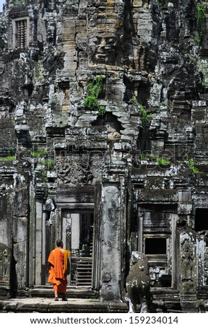 Monk and the temple - stock photo