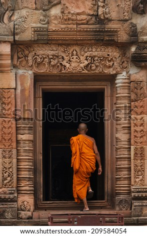 Monk in Prasat Phanomrung Historical Park.Buddhist Temple on mountain. Famous landmark, place of worship and popular tourist travel destination in Thailand.
