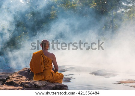 monk meditation at hot spring - stock photo