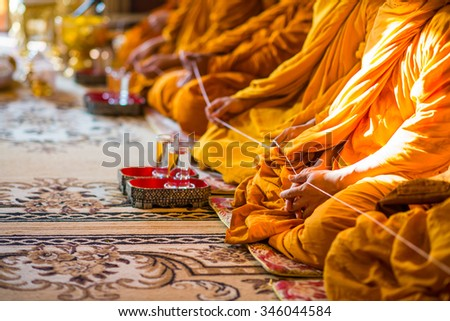 Monk's hand in Buddhism ceremony