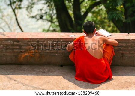 Monk student studying - stock photo