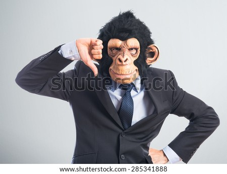 Monkey man doing bad signal over textured background