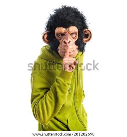 Monkey man making silence gesture  - stock photo