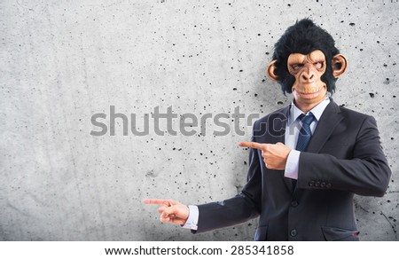 Monkey man pointing to the lateral over textured background