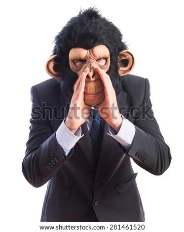Monkey man shouting over white background  - stock photo