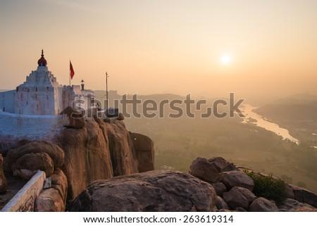 Monkey temple at sunrise hampi india  - stock photo