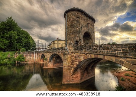 Monmouth, Wales, UK, August 4 2016 - Showing the Monnow bridge in Monmouth which is the only fortified bridge left in Wales, the bridge lies just on the Welsh side of the English boarder.