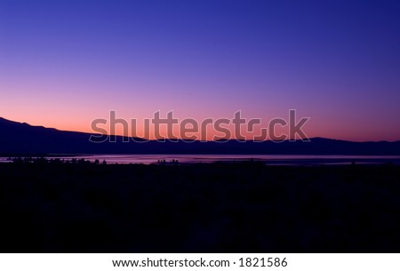 Mono Lake and the Sierra Nevada, just east of Yosemite National Park, at sunset. - stock photo