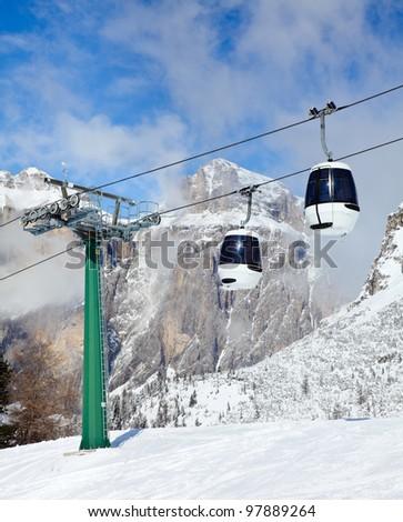 Monocable gondola lift at Val Di Fassa ski resort in Italy - stock photo