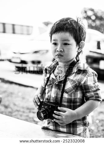 Monochrome beautiful asian boy - stock photo