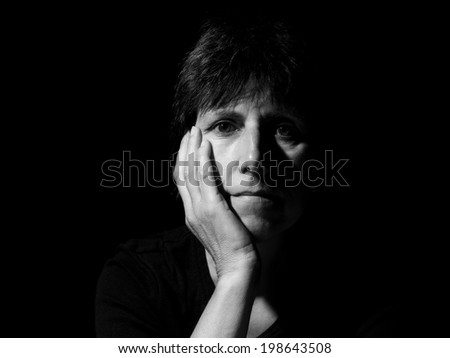 Monochrome black and white portrait, face of a woman, serious, pensive. - stock photo