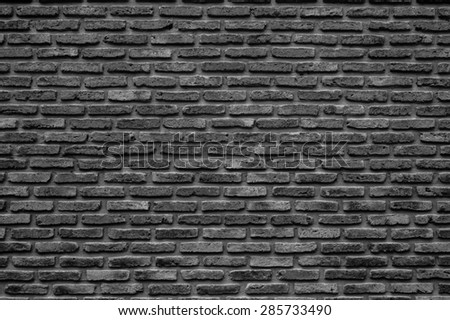 Monochrome brick wall texture, background - stock photo