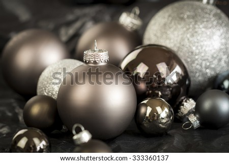Monochrome Close Up Still Life of Festive Christmas Balls in Variety of Textures and Hues in Selective Focus with Copy Space