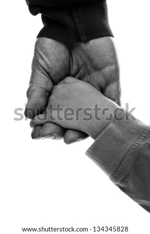 Monochrome closeup of an adult hand holding a child's hand on white - stock photo