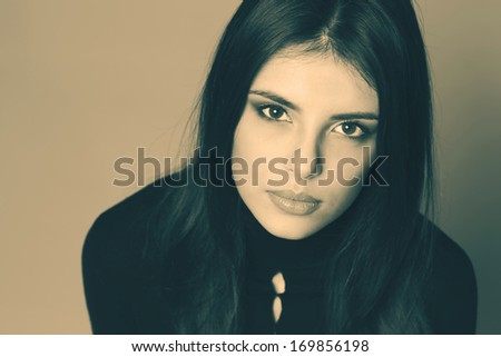 Monochrome closeup portrait of a pensive woman - stock photo