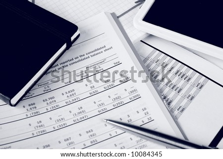 Monochrome daily financial reports, pen and notepad - stock photo