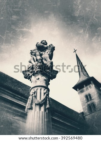 monochrome grunge vintage bottom-up representation of the fountain of Samson in front of the Our Lady basilica in the swiss city of Fribourg - stock photo