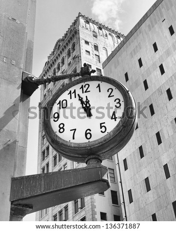 monochrome image of a downtown Miami street clock at a few minutes before twelve