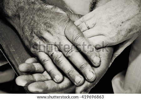 Monochrome image of old married couples hands. horizontal format