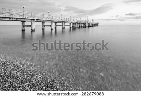 Monochrome image of the pier at day time. - stock photo