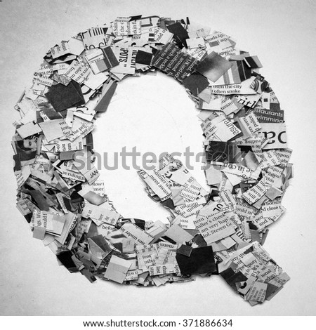 Monochrome letters made out of Newspaper - stock photo