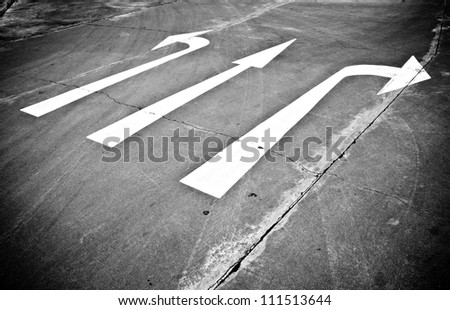 Monochrome of directional street sign - stock photo