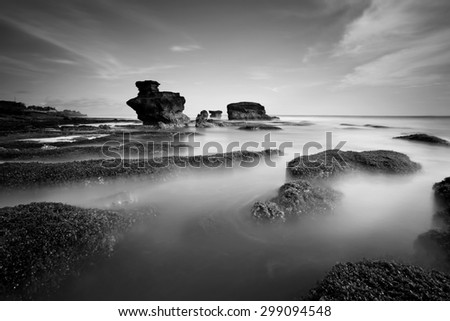 Monochrome of Melasti beach at evening in bali indonesia - stock photo