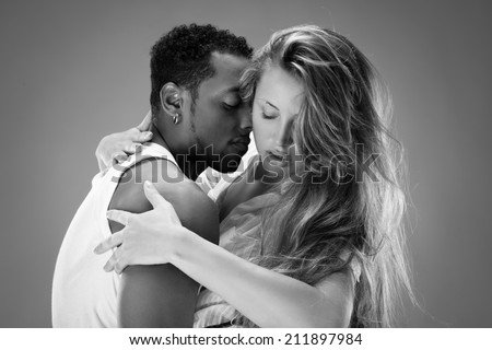 Monochrome portrait of a passionate couple - stock photo
