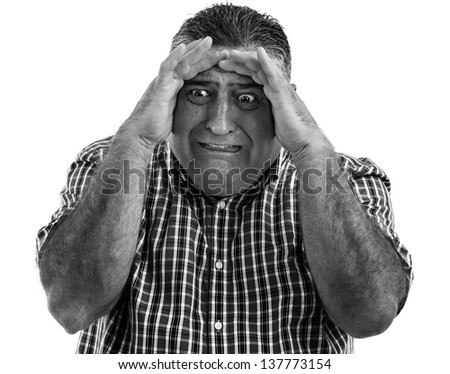 Monochrome portrait of a terrified man - stock photo
