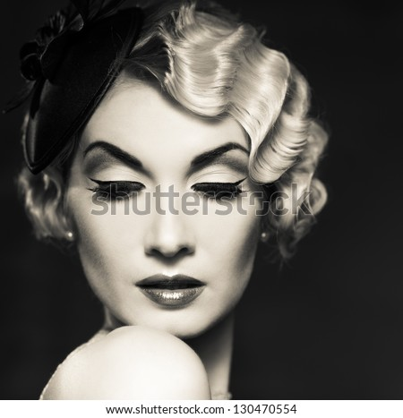 Monochrome portrait of elegant blond retro woman   with beautiful hairdo and little hat - stock photo