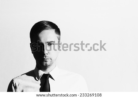 monochrome portrait of handsome man in tie. Businessman. Young man. Business