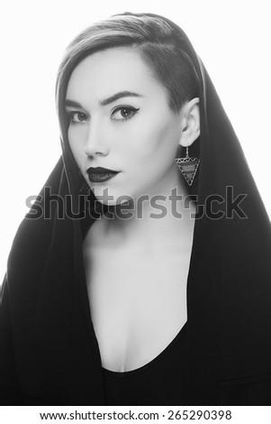 monochrome portrait of young woman in black hood.beautiful girl. fashion nun - stock photo