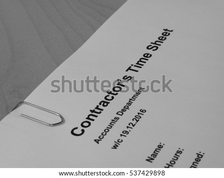 Monochrome representation of Sub Contractors weekly time sheet heading with shallow depth of field