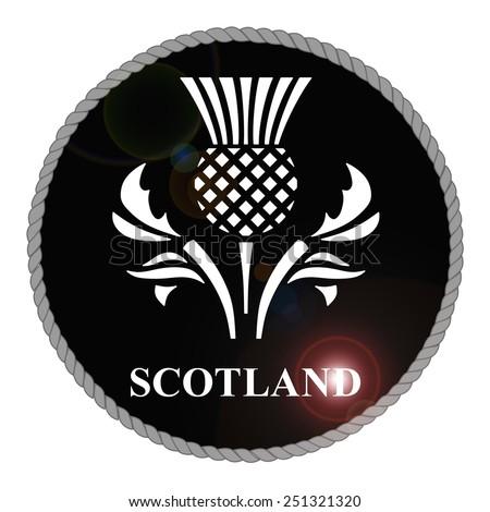 Monochrome Scotland emblem with lens flare isolated on white background  - stock photo