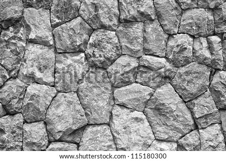 monochrome shot of stone wall texture background - stock photo