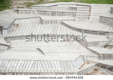 Monochrome striped textured geometric staircase.Pattern line.Gray,grey wooden stripes.Up,down.Contemporary wood tiled stairway.Many different levels,roads,ways,choices, ideas,layers,forms. Nobody - stock photo