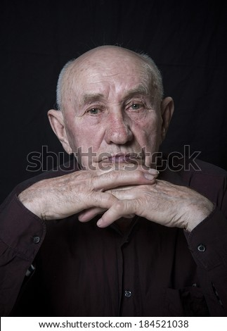 Monochrome stylized portrait of an expressive old man - stock photo