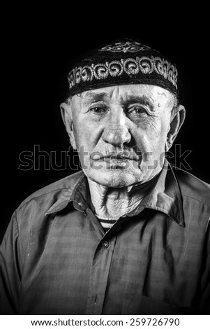 Monochrome stylized portrait of an expressive old man - stock photo
