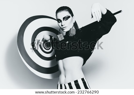 monochrome woman in top with umbrella on shoulders in studio - stock photo