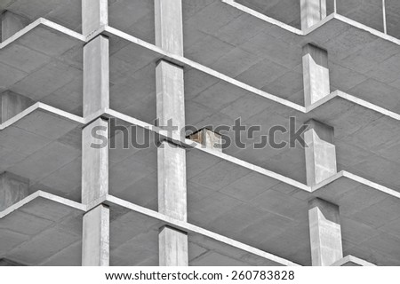 Monolithic building construction site work from concrete - stock photo